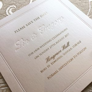 Ivory and gold save the date card